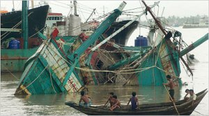 Boys look onto wrecked fishing boats after Cyclone Nargis. Photo Credit: NYT